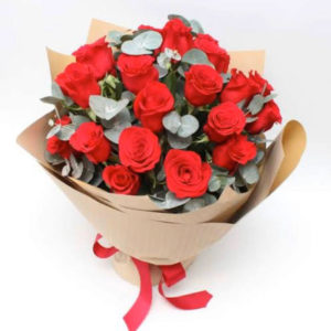 20 red roses wrapped in brown paper