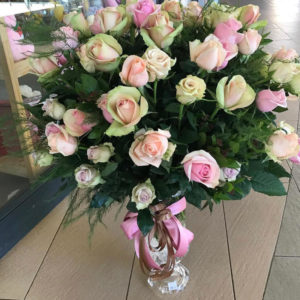 50 soft colours mixed roses in a vase